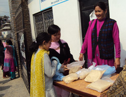 Income Generation Program (Supperflour selling by a member)